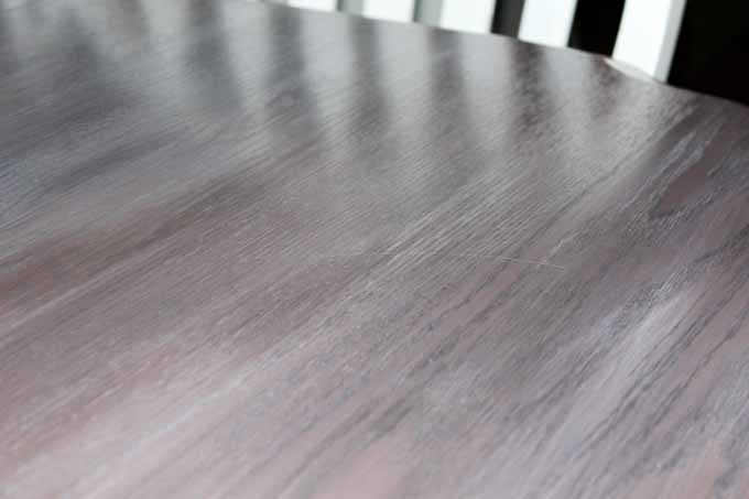 Small scratch on surface of kitchen table two years after using Minwax Polycrylic