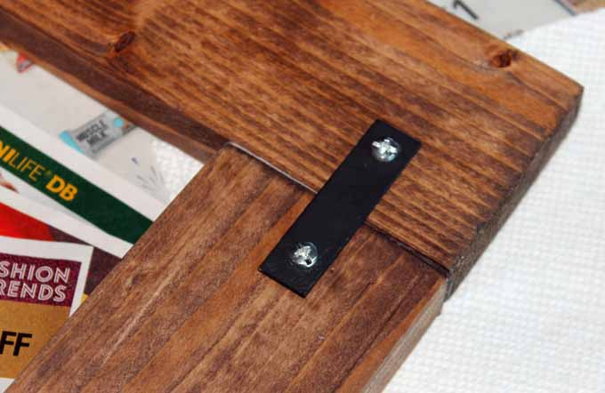 Using the mending plates to secure the boards together after using wood glue.