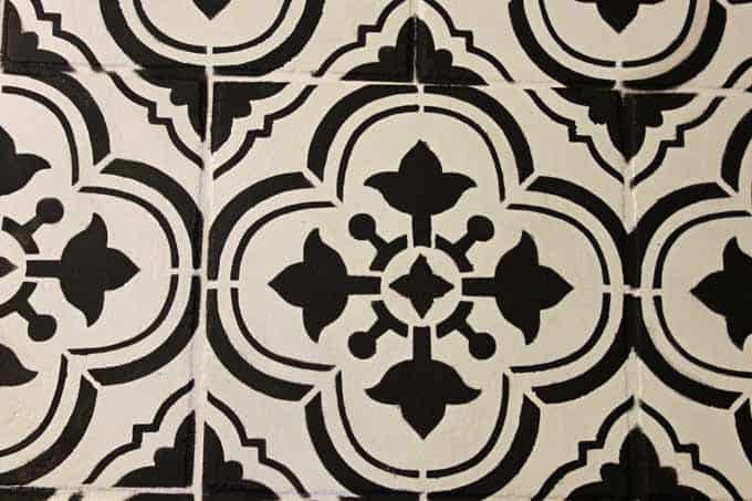 Close up shot of imperfections after using Santa Ana stencil to update tile floor.