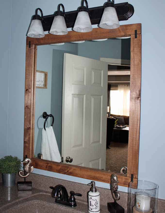 Nimbus blue bathroom with framed mirror