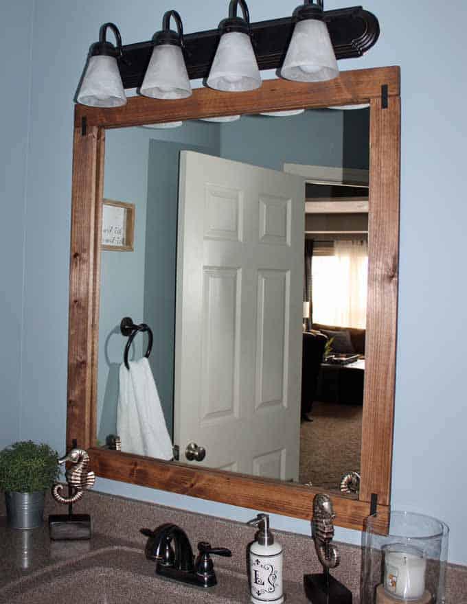Nimbus blue bathroom with framed mirror