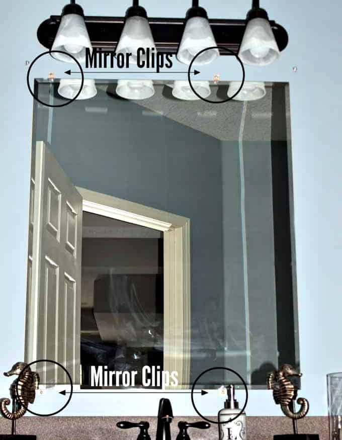 Mirror clips were used to install the builder's grade bathroom mirror