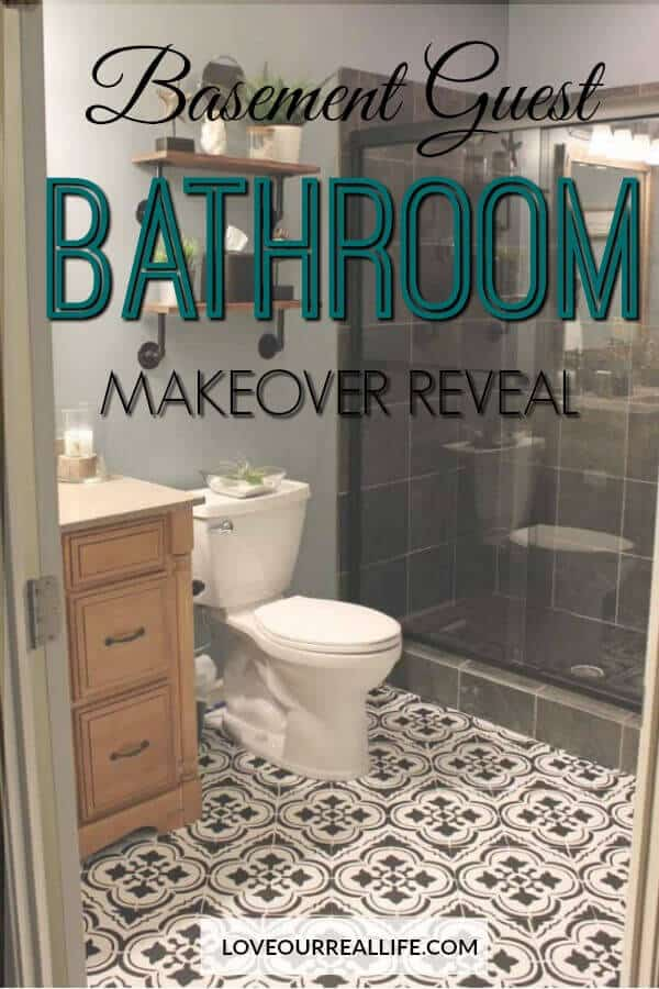 Basement Guest Bathroom with stenciled floors and DIY wood shelves