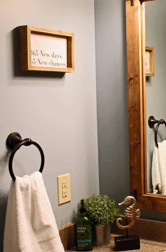 """Farmhouse bathroom decor, """"365 New Days, 365 New Chances"""" sign."""