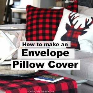 Red and black buffalo plaid envelope pillow cover and buffalo plaid deer head pillow.