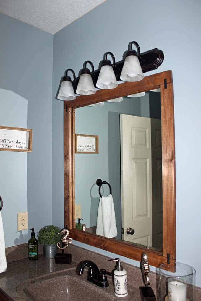 Nimbus Gray paint by Benjamin Moore was used in the guest bathroom; DIY wood framed mirror.;