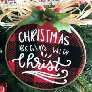 "Buffalo plaid Christmas ornament with ""Christmas Begins with Christ"" on front"