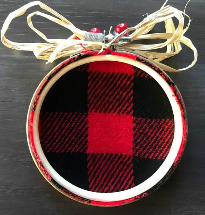 Back side of the buffalo plaid embroidery hoop Christmas ornament.