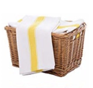 White dish towel with yellow stripe in wooden basket