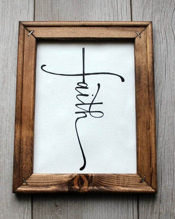 Faith reverse canvas sign in stained wood frame