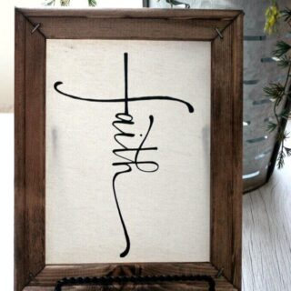 """reverse canvas sign """"faith"""" displayed by a window"""