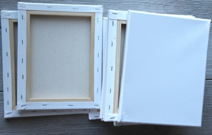 stack of white canvas on rustic faux wood tile