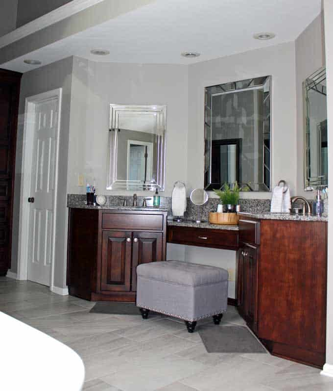Master bathroom in Mindful Gray by Sherwin Williams with double vanity and sinks.