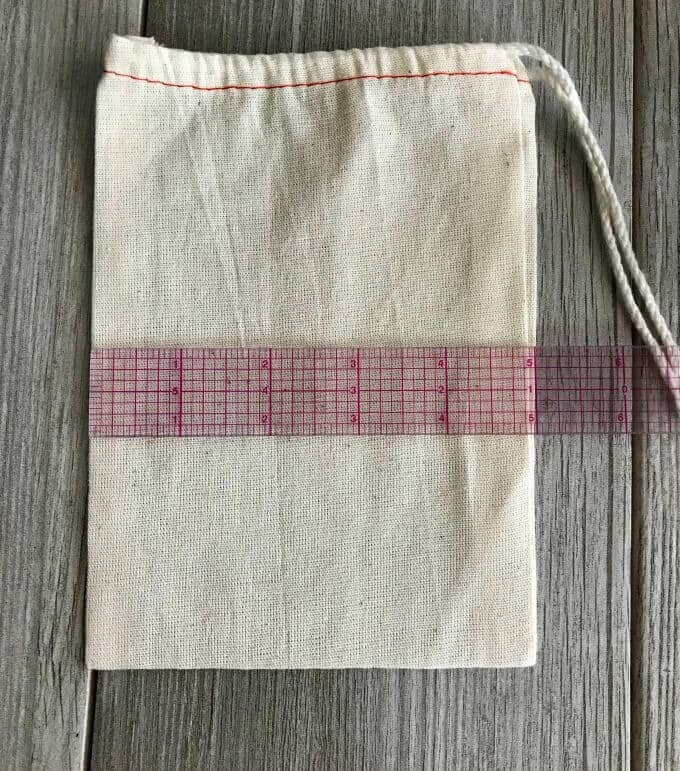 Measuring tic tac toe grid for bag