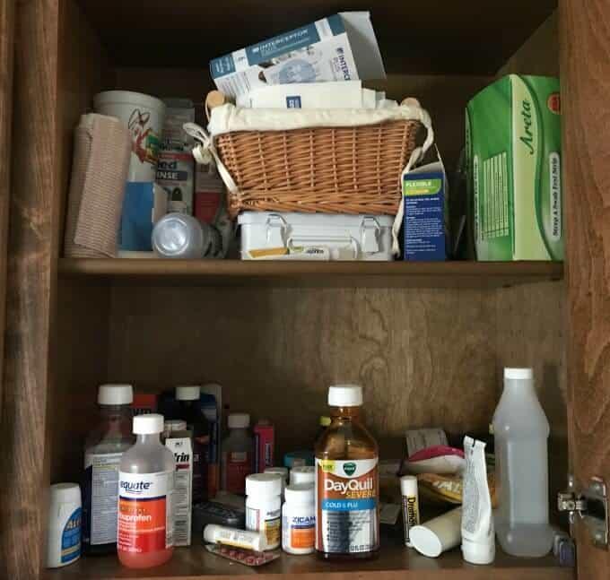 Close up photo of medicine cabinet BEFORE organization.