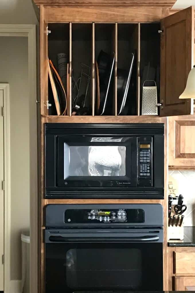 Vertical space above oven for storage of cookie sheets, cutting boards, shredders, etc.