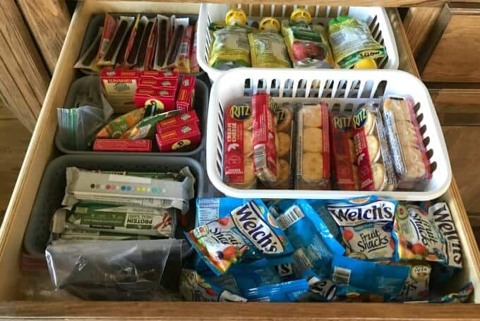 Lunch snacks organized in drawers in small dividers.