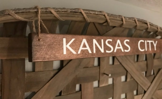 Kansas City wooden sign in tobacco basket hanging with jute twine.
