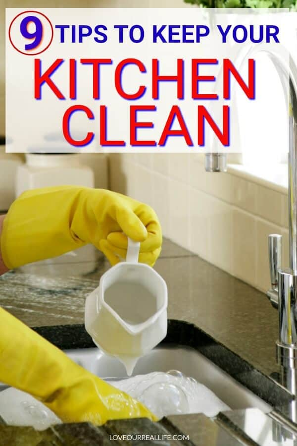 Cleaning dishes with rubber gloves