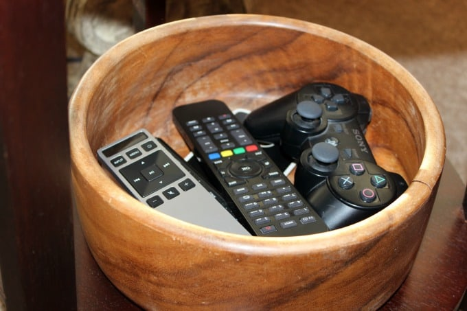 Wooden bowl to keep all of the remote controls neat and tidy in the living room.