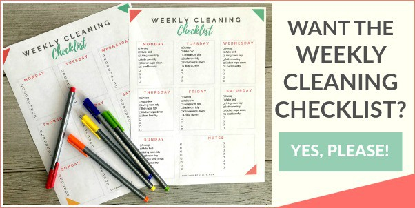 Weekly cleaning checklist on wood floor background