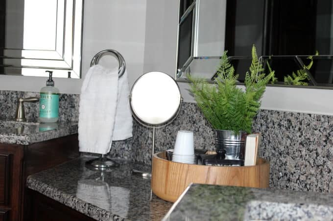Clean a bathroom counter daily with a hand towel or washcloth for a tidy bathroom space.