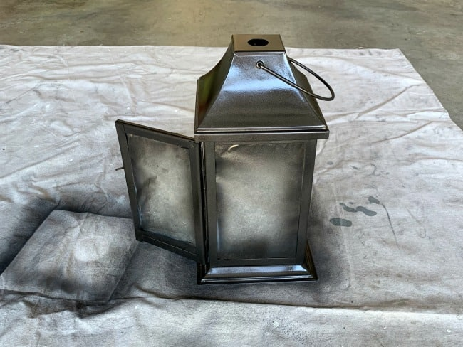 Adding metallic spray paint oil rubbed bronze to lantern.