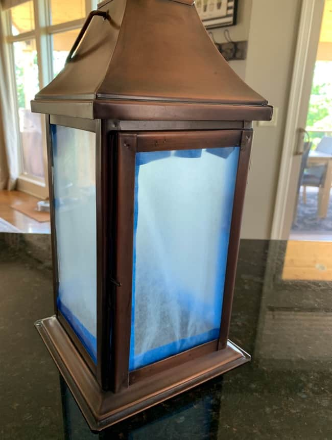 Cover glass in lantern with wax paper and painters tape prior to painting
