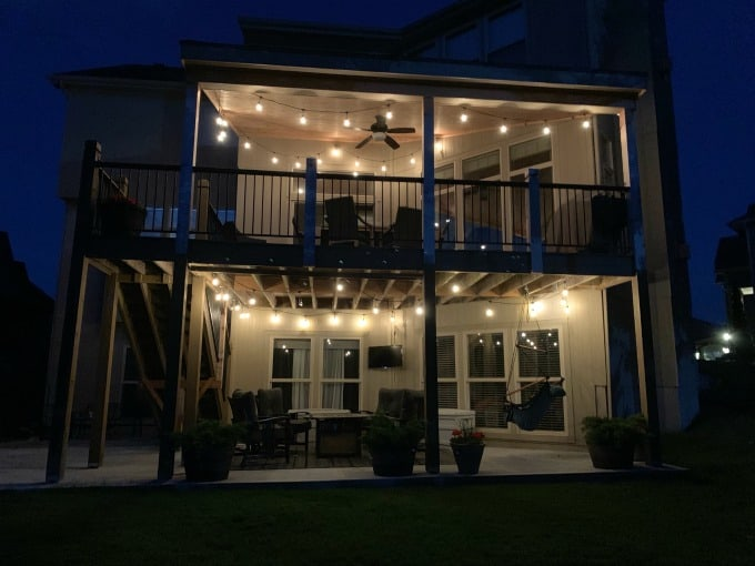 Deck and patio at night with string lights