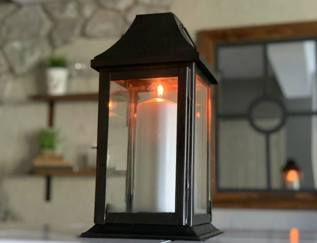 Spray painted lantern with candle burning.