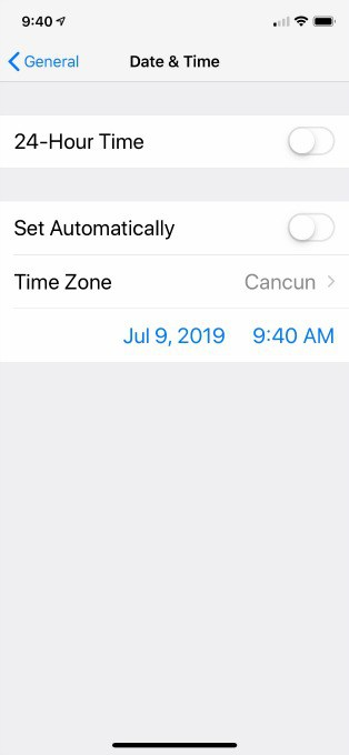 Adjusting cell phone settings for time zone.