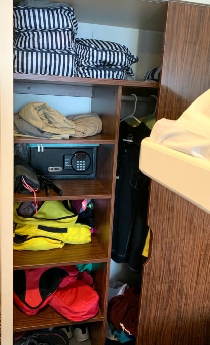 Packing cubes used to organize items in closet on cruise.