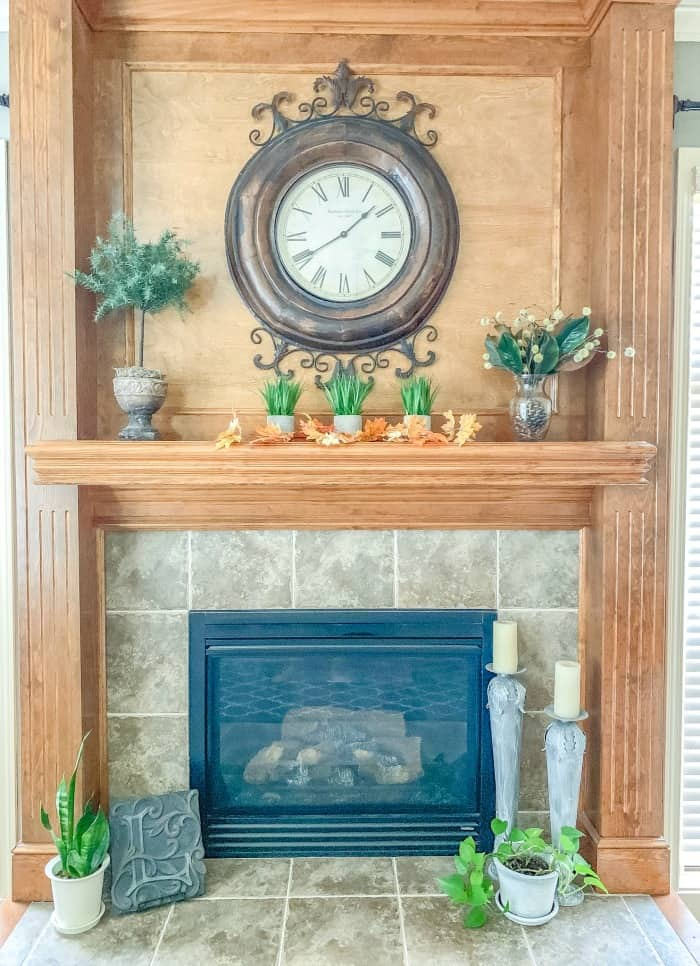 Mantel with autumn leaves garland and magnolia leaves