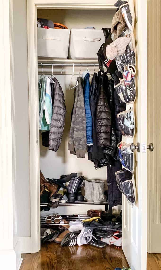Messy entryway closet before organizating