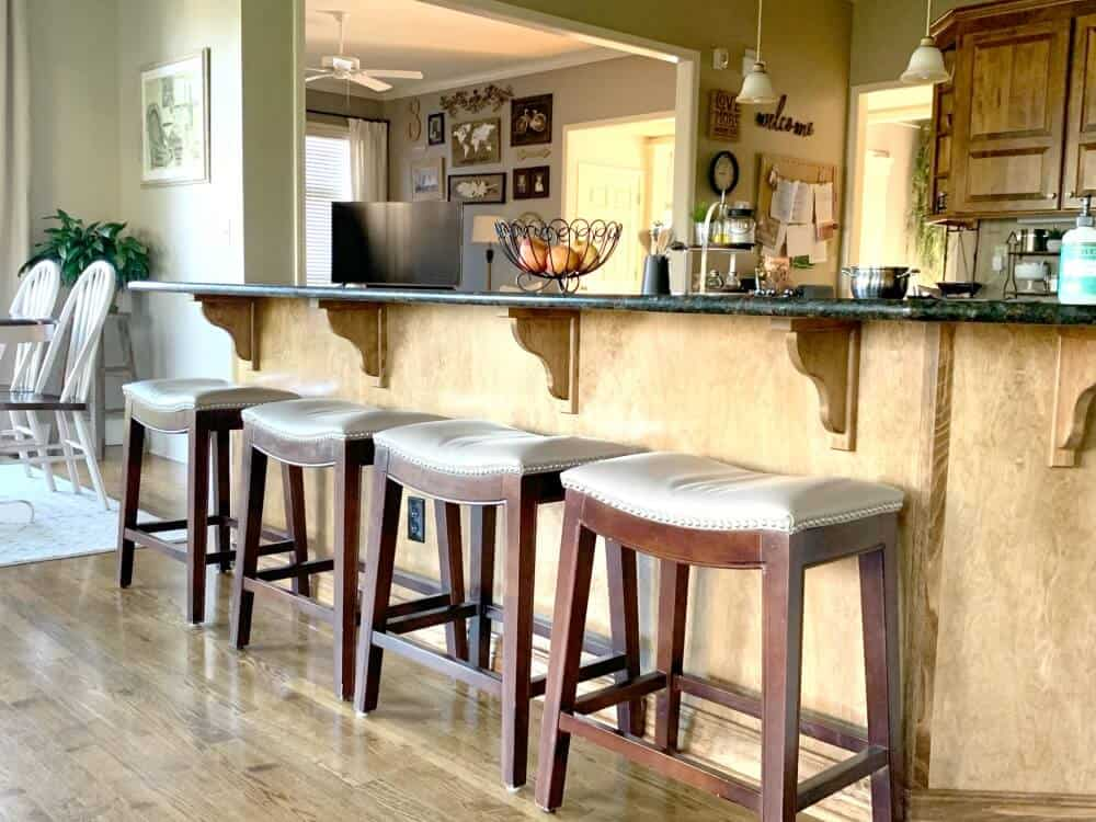 Brown wooden kitchen stools before painting with white chalk paint.