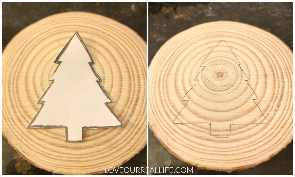 Transfer christmas tree template to wood slice by tracing.