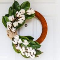 DIY winter wreath with magnolia leaves, cotton, and leather