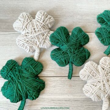 green and linen yarn clovers