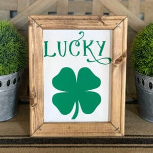 Green and white lucky canvas sign on table runner