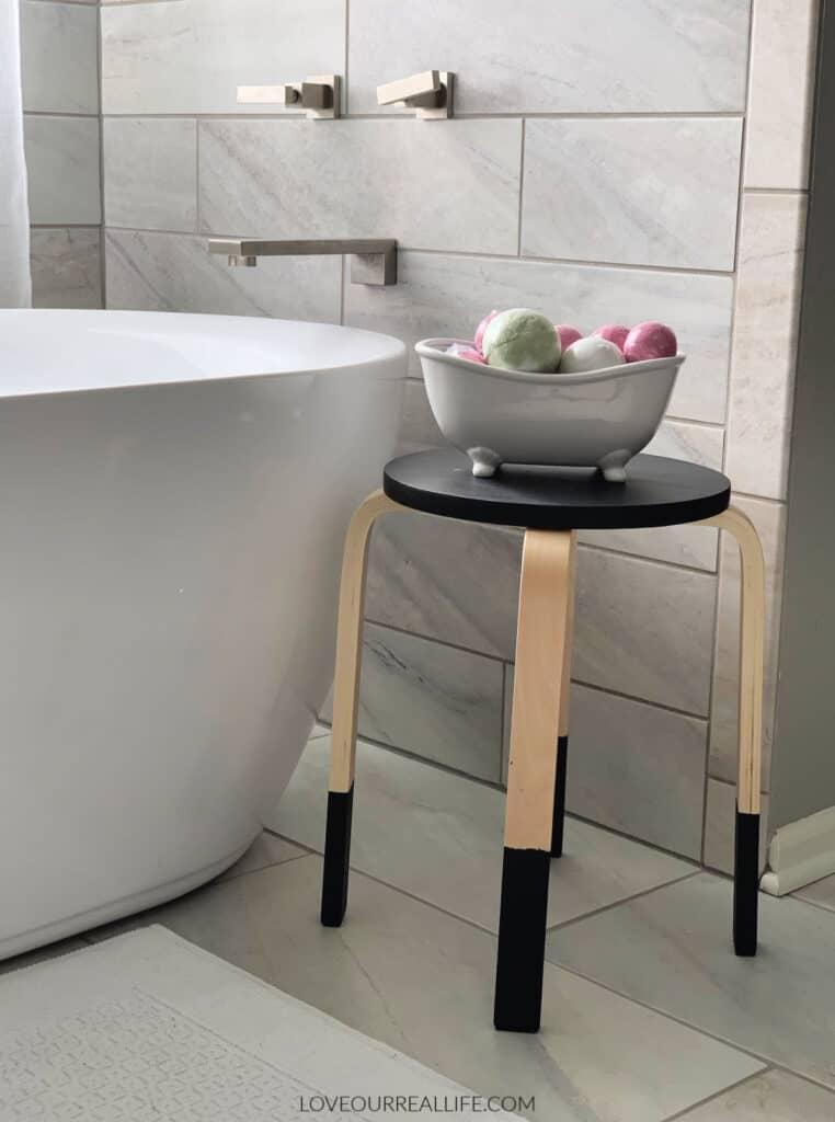bathtub and stool with bath supplies