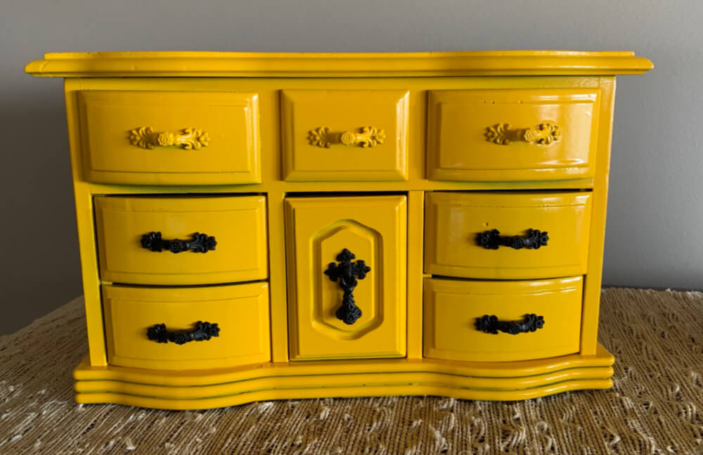 Glossy yellow jewelry box with hardware painted black matte.