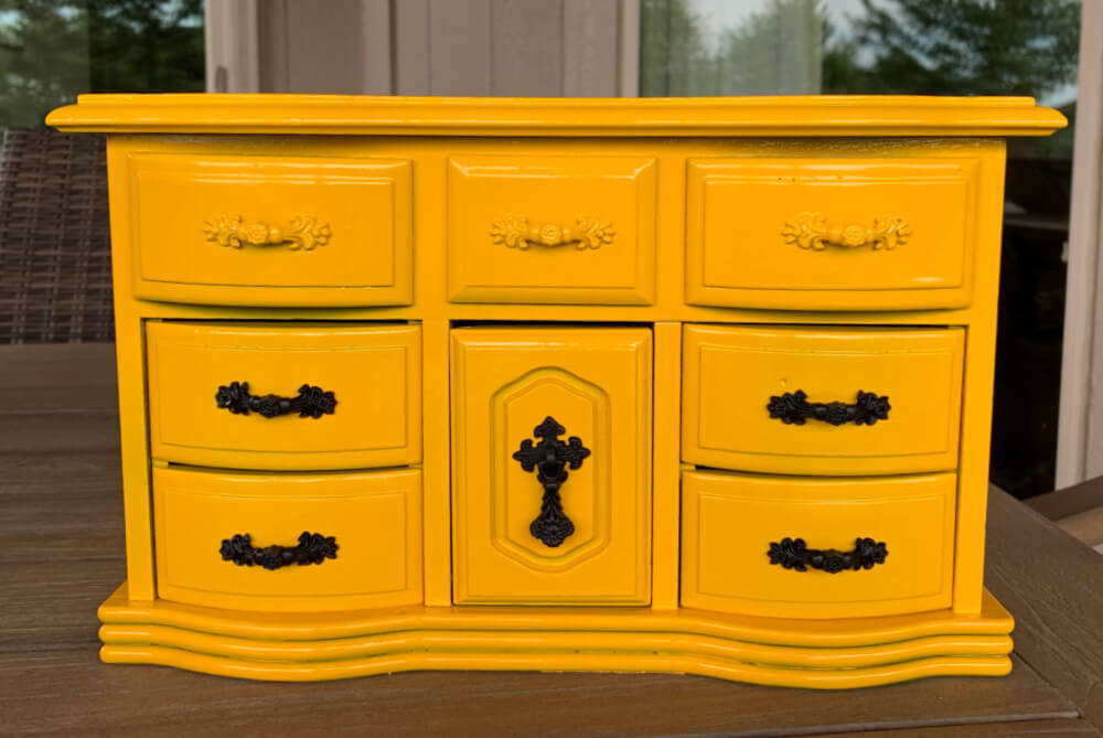 front of yellow jewelry box