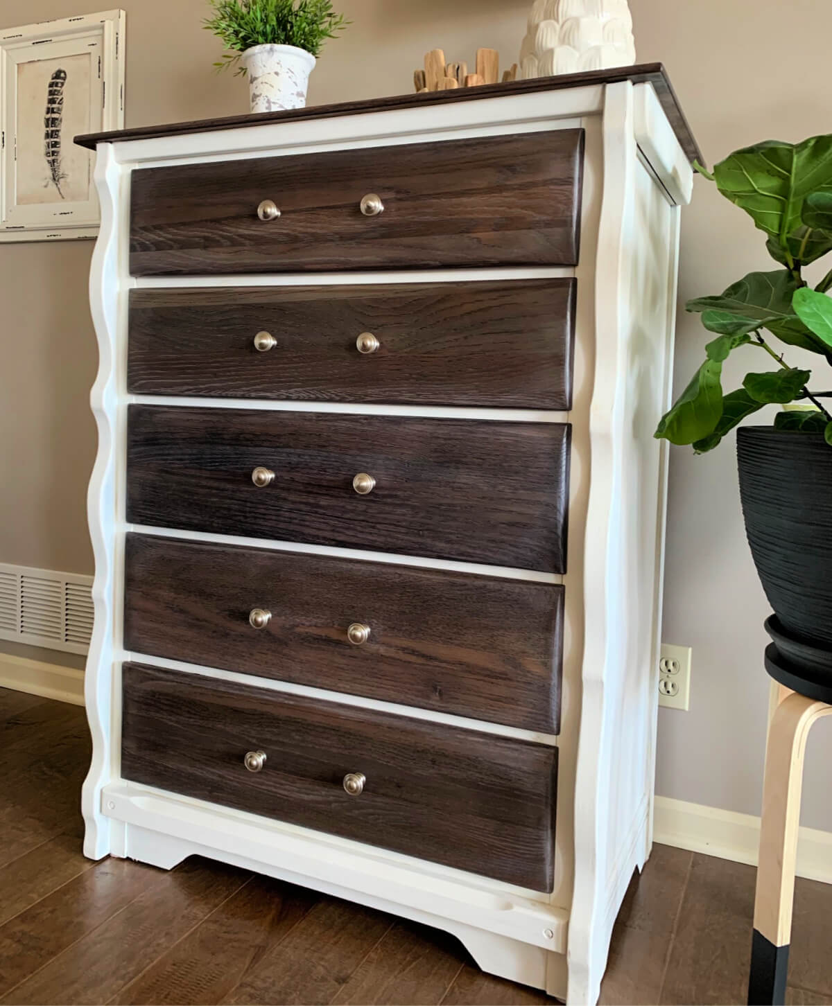 White dresser with gray stained top and drawers.