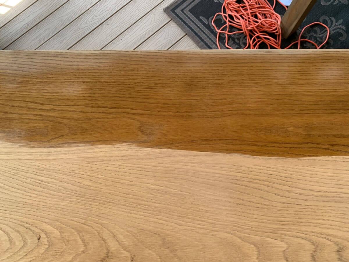 Adding protective coat over weathered wood.