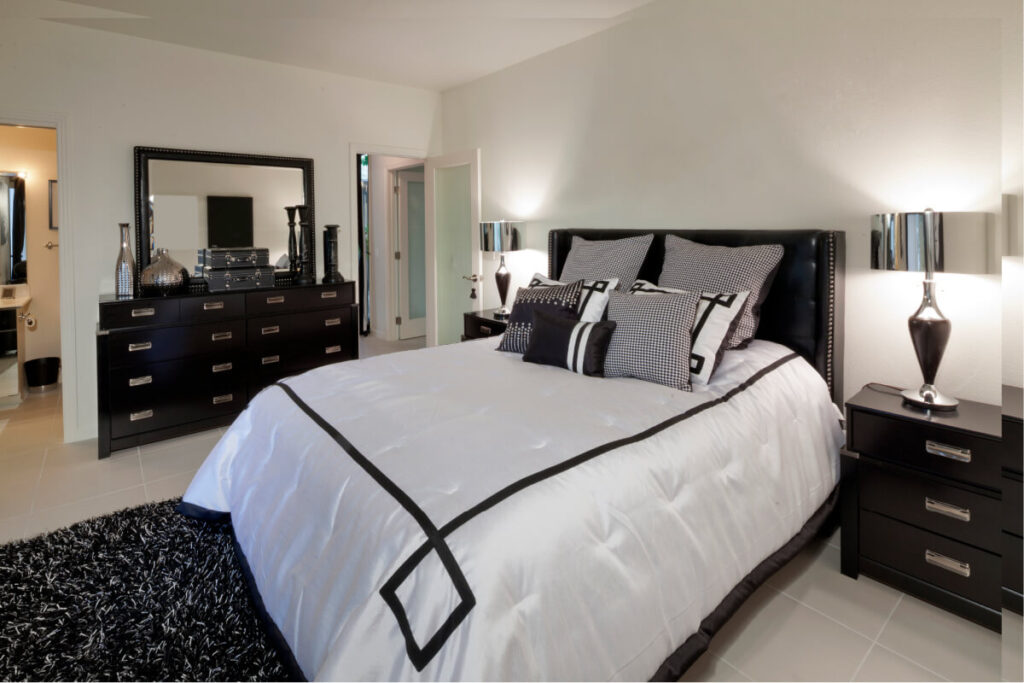 black bedroom furniture and white and black bedding