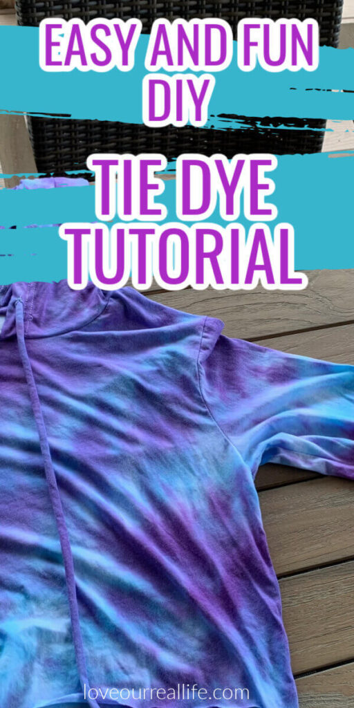blue and purple tie dye shirt on wood table.