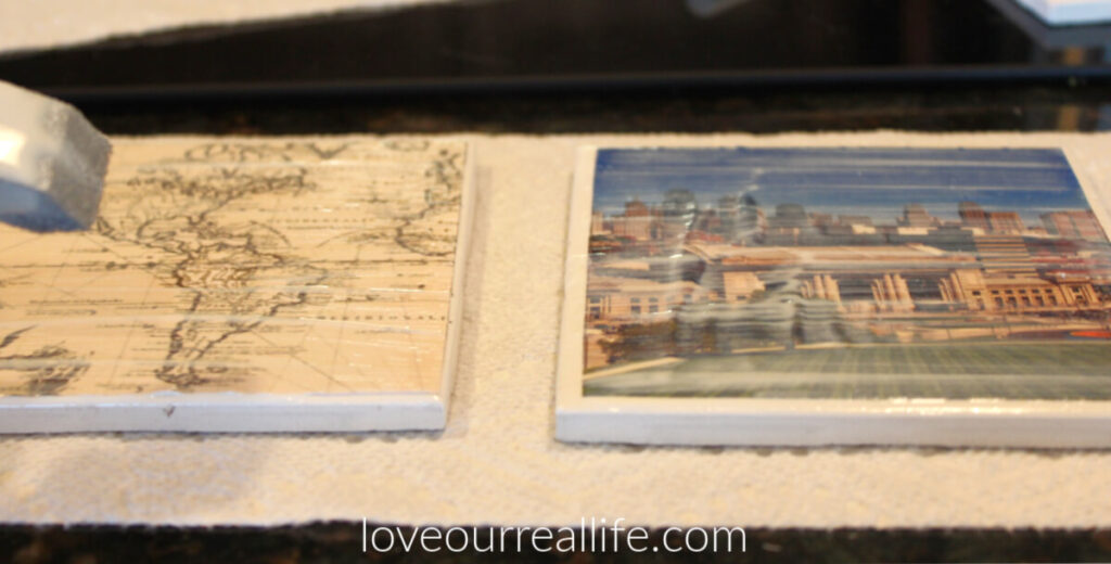 applying layer of mod podge on photos to personalize ceramic tile coaster.