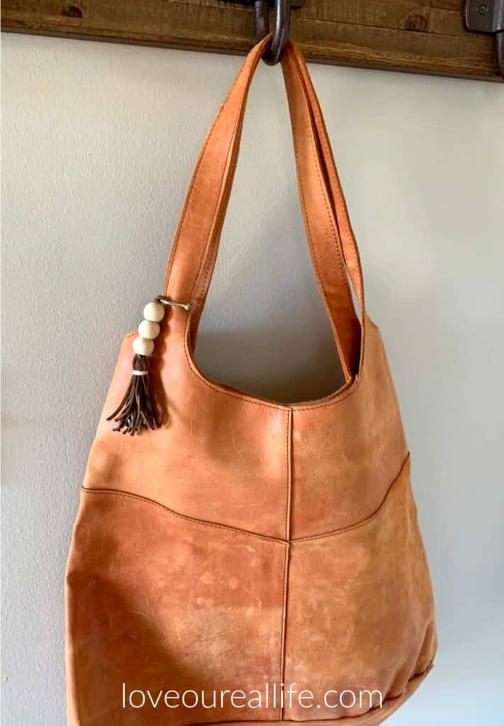 Vintage leather tote with wood bead and tassel keychain
