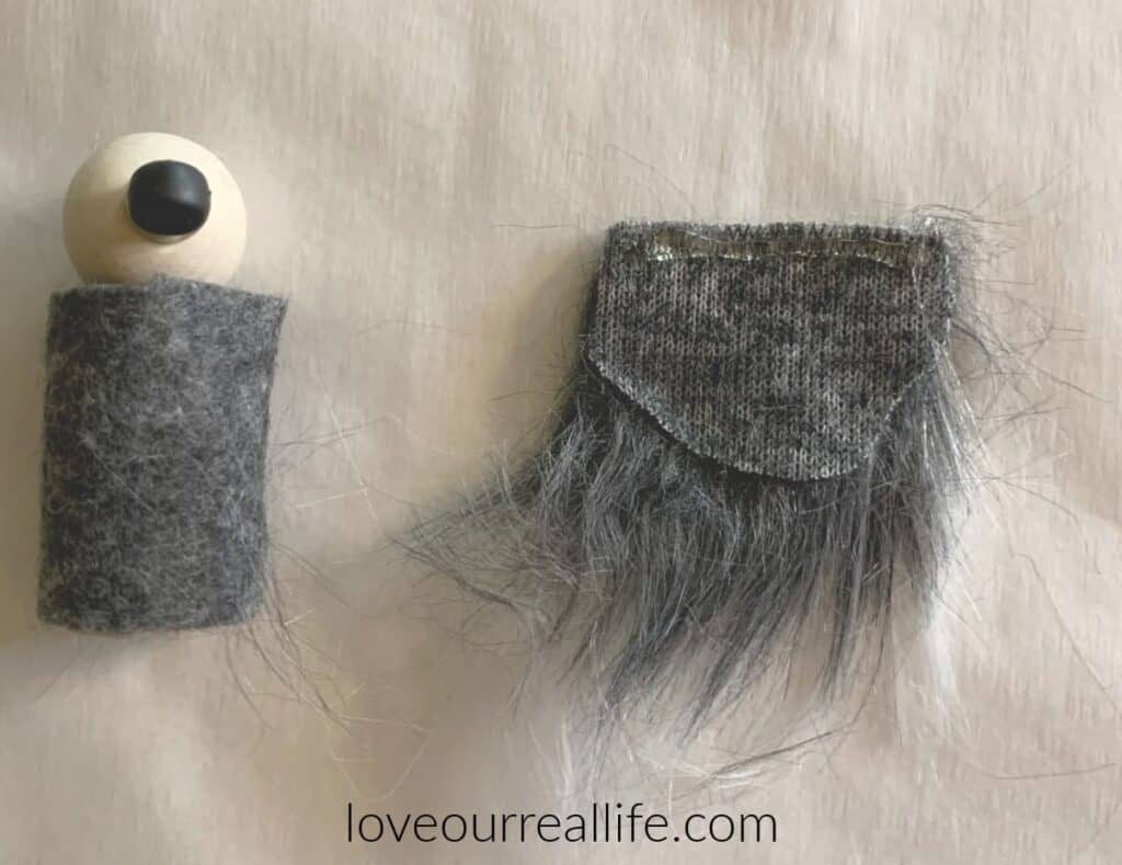 gray faux fur used as beard for wood peg doll