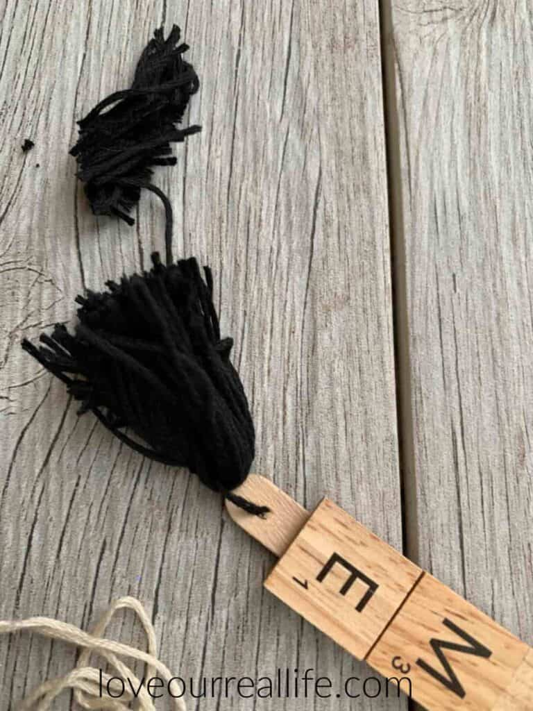trimming edges of black tassel to make even